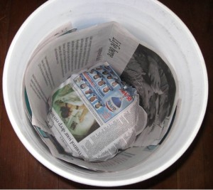 lininrg bucket with newspaper