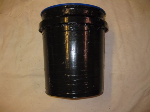 space bucket covered in black tape