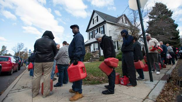 Jerrycan lineup after Hurricane Sandy - source Globe and Mail