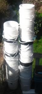 stacks of 5 gallon buckets