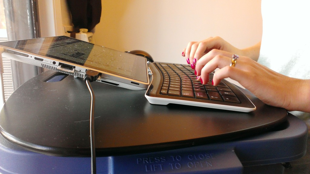 typing-on-keyboard-tablet