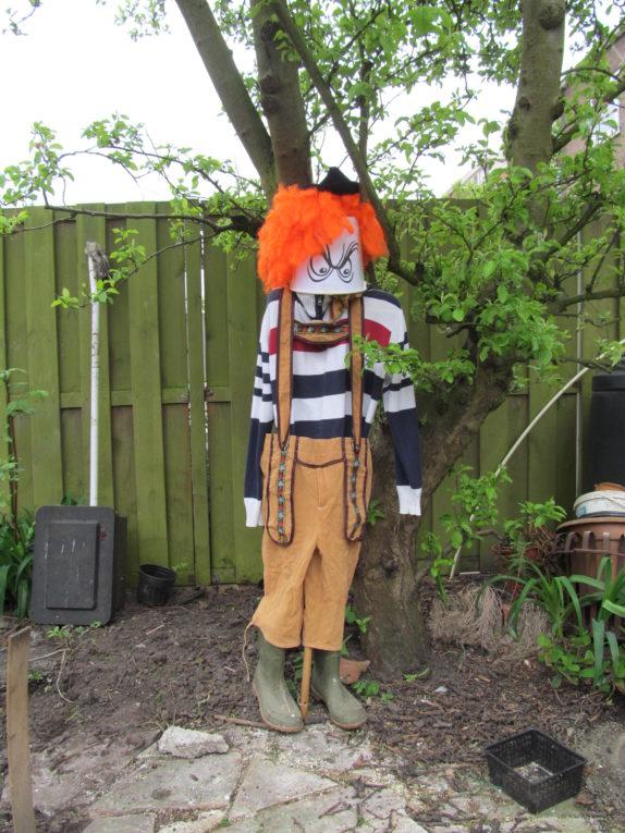 scarecrow bucket orange hair pants boots